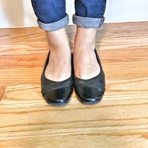 Black leather flats
